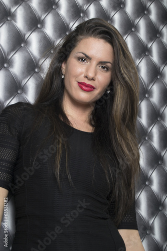 Beautiful woman with long dark hair (studio portrait)