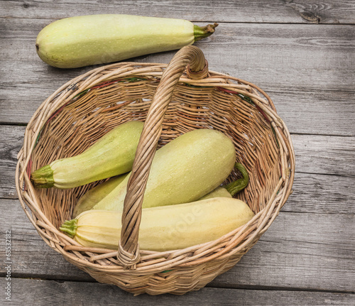 Basket with fresh zucchini
