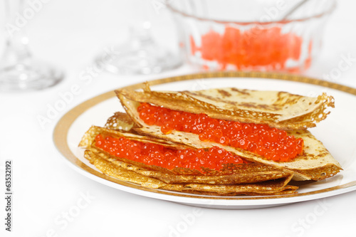Pancakes with caviar.