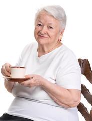 Old woman enjoying coffee or tea cup