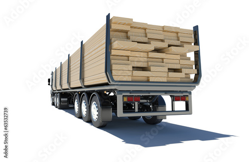 Truck transporting lumber. Rear view