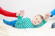 divorced parents holding sad child separately - 63532951