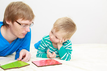 father and son playing with puzzle