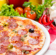 pizza closeup with salami sausages
