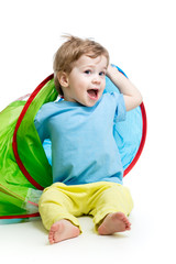 cheerful baby playing in a tent