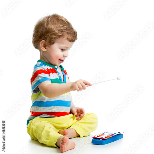 Cute baby playing with musical toys