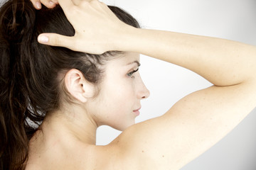 Image of purity of woman holding hair in ponytail
