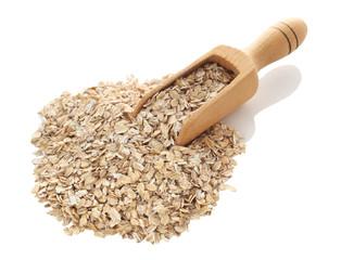 Oat flakes in wooden scoop