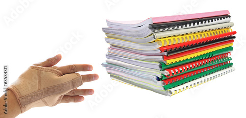 Stack of books with hand pain isolated