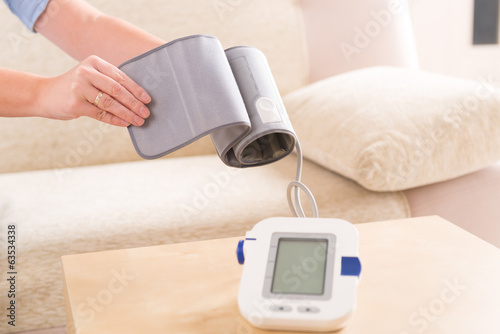woman checking her blood pressure