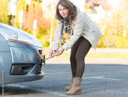 Woman assembling towing hook