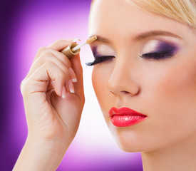 Beautiful blonde girl with purple makeup