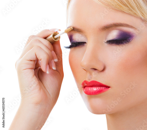 Beautiful girl with purple makeup