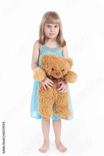 The girl keeps a toy bear
