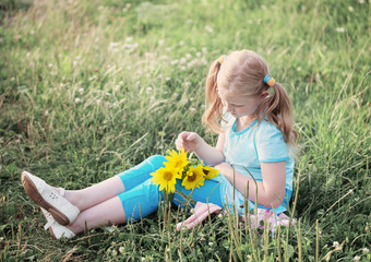 girl with sunflowers outdoor