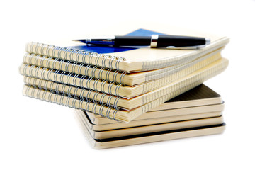 Pile of notebooks isolated on a white background