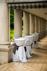 Wedding or party venue preparation with covered bar tables