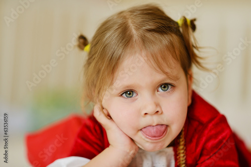 toddler girl showing tongue out