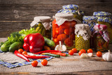 Fototapety Preserved  and fresh vegetables on wooden background