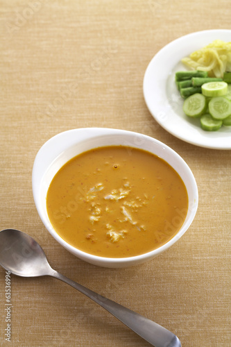 thai yellow curry and vegetable in studio light