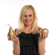 Attractive woman holding a golden pear and apple