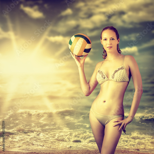 Young beautiful slim volleyball woman