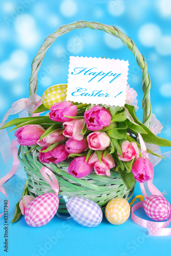 easter basket with tulips and eggs