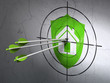 Business concept: arrows in Shield target on wall background