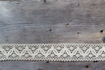 Lace on old wood background