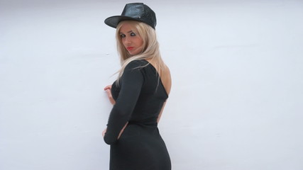 sexy woman wearing black leather hat and dress on white