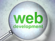 SEO web development concept: Web Development with optical glass