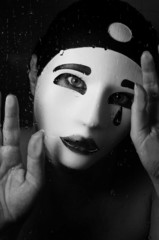 a portrait with Pierrot mask with tears