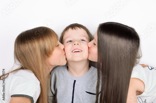 two girls kissing boy
