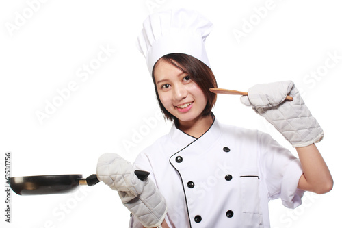 Young and happy beautiful girl preparing lunch