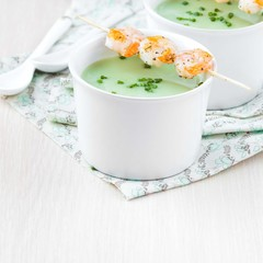 Velvety green cream soup of broccoli, peas, spinach, fry shrimp