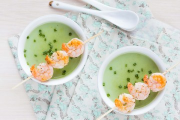 Velvety green cream soup of broccoli, peas, spinach, fry shrimp