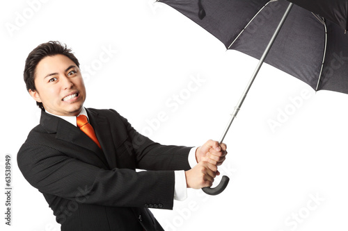 Angry businessman with umbrella