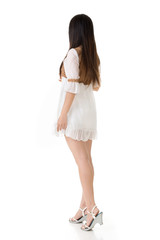 Rear view of Asian woman with white short dress