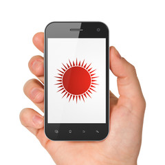 Vacation concept: Sun on smartphone