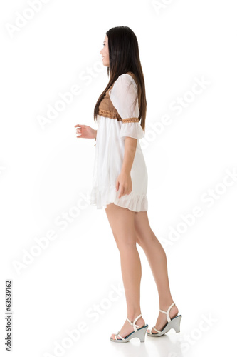 Side view of Asian woman with white short dress