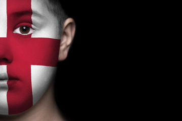 Human face painted with flag of England