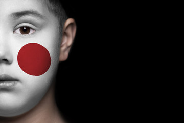 Human face painted with flag of Japan