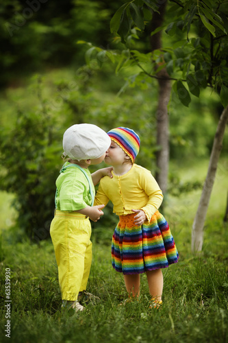 Boy with a girl in bright colored clothing
