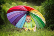 cute boy under colorful umbrella