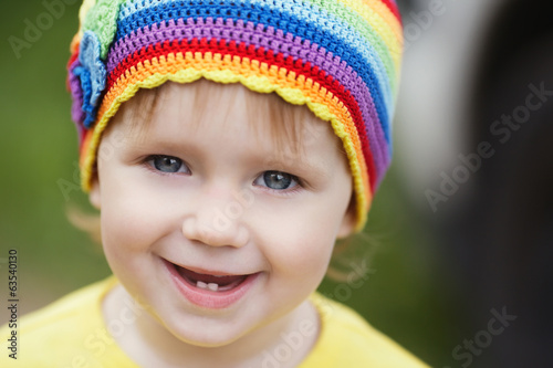 cute little girl portrait with rainbow hat