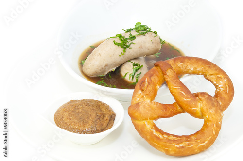 sausages in beer sauce with mustard and pastries