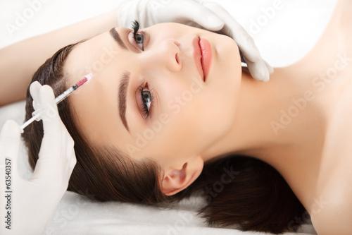 Fototapeta Beautiful woman gets injections. Cosmetology. Beauty Face