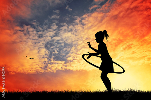 girl plays at sunset