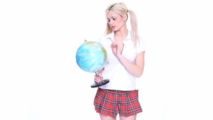 Beautiful cute blond woman holding a globe