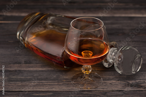 Cognac on  wooden background